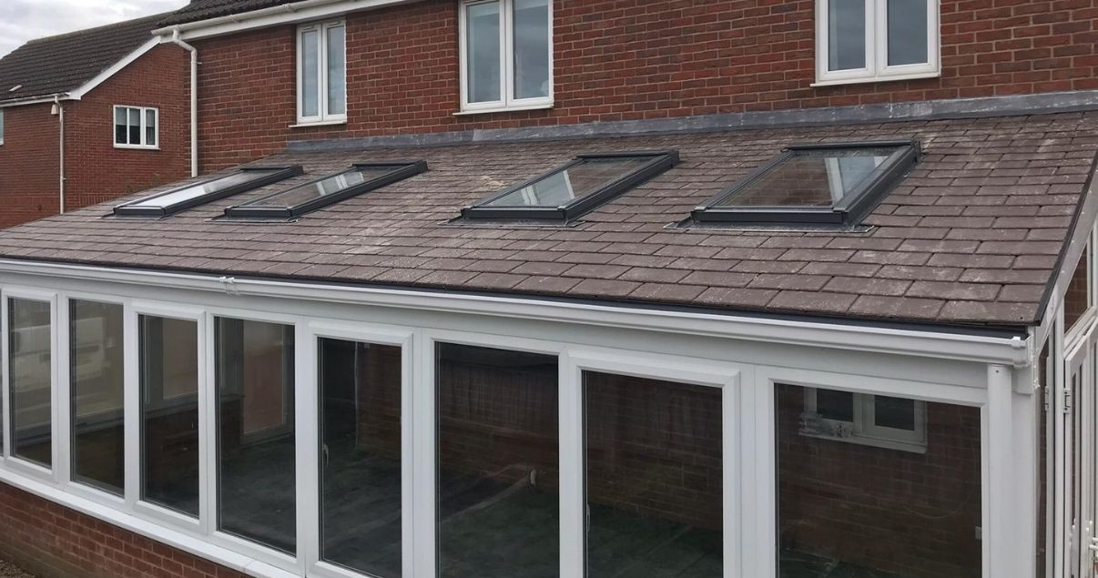Solid conservatory Guardian roof with velux skylines that provide a brighter interior