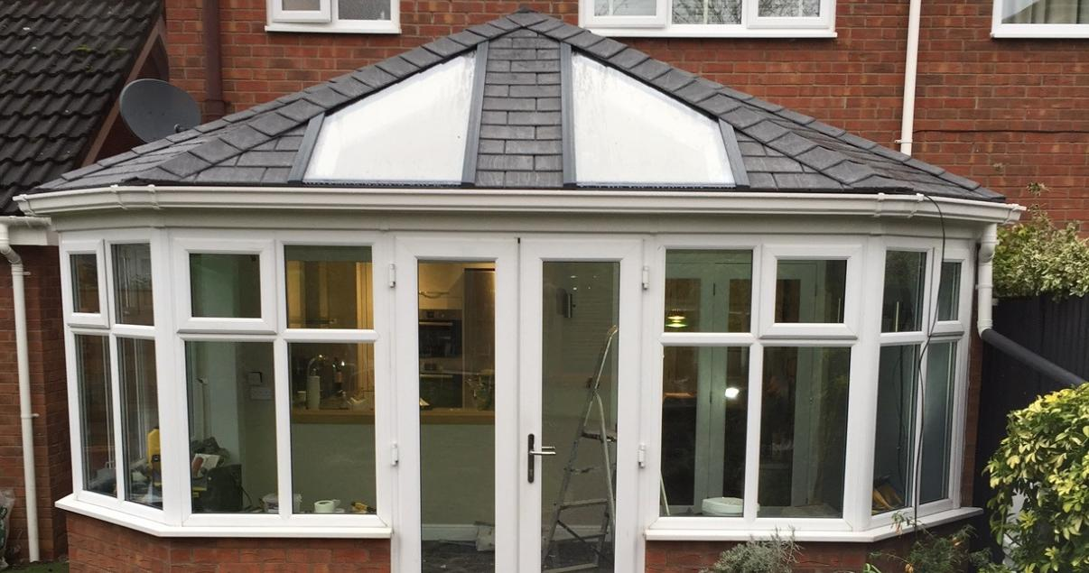 solid conservatory roof with stylish skylights